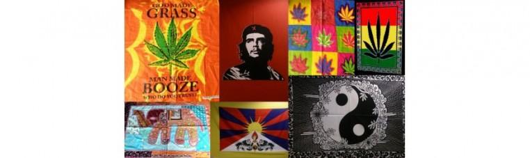 Tentures batiks or flags representing various logos or characters.