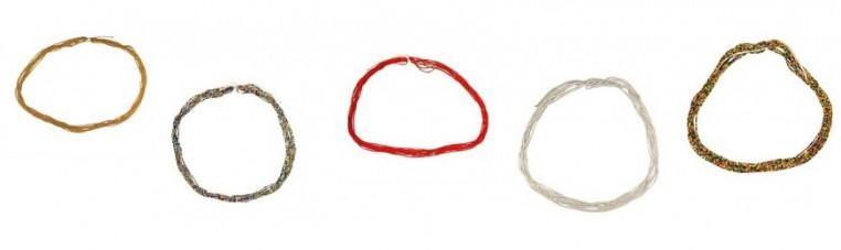 The baya kidney tower in fine beads is worn around the kidneys.